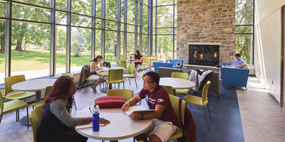 students hanging out in the Blue Apple Cafe fireplace room
