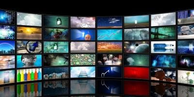 wall of televisions showing different channels