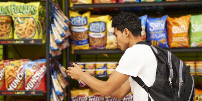 student browsing through packaged snack options
