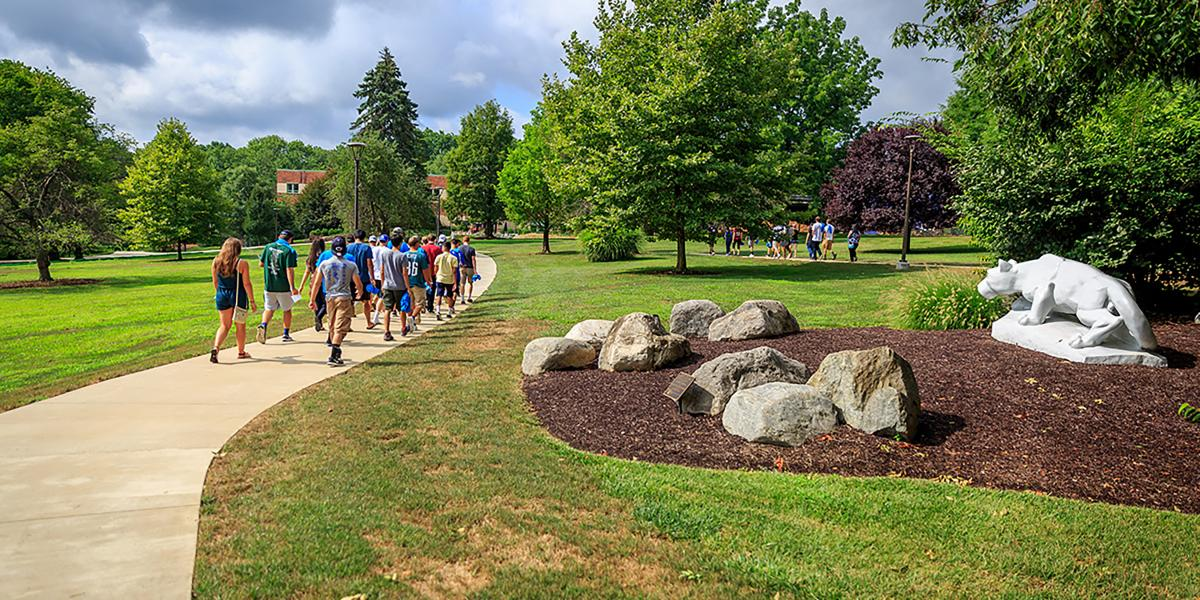students walking by the Lion Shrine